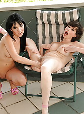 Mature and her younger girlfriend in fisting act