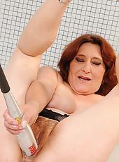 Hot grannys inserting a baseball bat into herslef