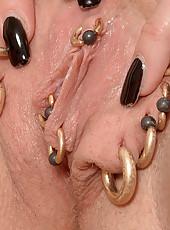Hottie with piercings gets off in living room