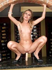 Mature hottie fucks her huge dildo in kitchen