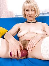 Hot blonde milf fucks her snatch