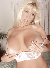 Busty blonde milf explores her pussy