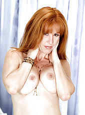 Raunchy 50 yr old redhead is in heat