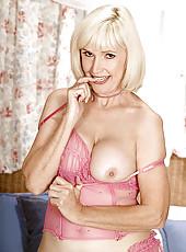 Older blonde lady in pink lingerie