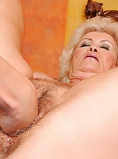 Horny and hairy mature Effie in a lesbian scene
