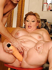 Chubby grandma with big tits teasing her old pussy