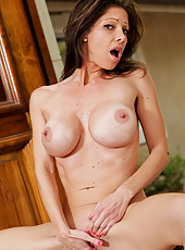 Hot milf Angel shows off her big breasts as she pleasures her needy pussy