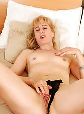 Horny milf stuffs a black dildo deep in her mature pleasure hole