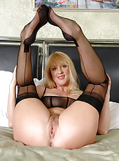 Check out Anilos Bethany Sweet as she nails her hairy cougar pussy with a big dildo