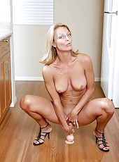 Orgasm starved busty milf bounces on her favorite dildo on the kitchen floor