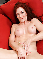 Beautiful milf Catherine Desade uses her fingers to pleasure her cougar pussy