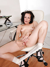 Seductive milf Claudia Adkins enjoys banging her horny pussy with her long glass dildo at work