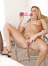 Sensual cougar Darryl Hanah lovingly torments her shaved pussy with the rabbit