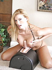 Platinum blonde Anilos milf titty fucks the sybian dong before sitting on it with her glistening pussy
