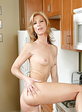 Lovely Anilos Dee Dee spreads her long legs ro reveal her honey filled snatch