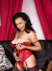 Captivating Anilos Donna shows off her ample breasts with their large brownish areolas
