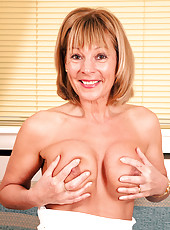 Sultry Elaine pops out her Anilos boobs while teasing on the sofa before she takes off her clothes