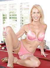 Seductive blonde milf gently strokes her Anilos pussy with a dildo on top of the billiard table