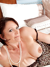 Sex starved cougar Foxy pulls her pearl necklace out of her hungry pussy