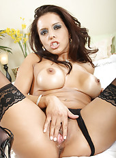 Cougar in stockings fucks her moist pussy with a vibrator
