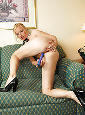 Gorgeous Milf Heidi Hanson licks her dildo and spreads her legs wide open on the couch