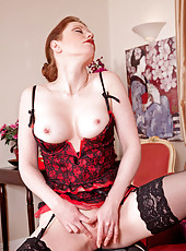 Seductive mature stewardess satisfies her cock craving mature pussy