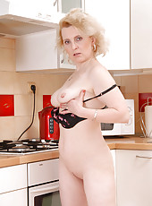 Sophisticated Anilos housewife thinks about her husband as she finger fucks her milf pussy in the kitchen