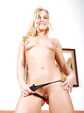 Sensual blonde cougar Janet strips off her clothes and spreads her milf pussy wide