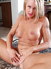 Blonde cougar slips off her bra and panties to display her naked flesh