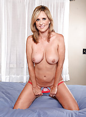 Busty Jodi West strips off her bra and panties and fingers her pussy hole