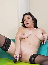 Mature busty Anilos Karen Kougar fucks her pussy with a huge purple dildo