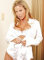 Lusty blonde cougar shows off her ample breasts with their large brownish areolas