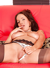 Horny business woman Marlyn shows off her luscious tender tits and hot mature pussy on the couch