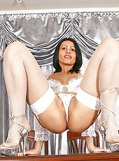 Exotic milf nelli portrays her flexibility by lifting her long legs above her head, giving a mouth watering view