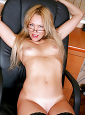 Anilos Olga fingers her shaved pink pussy to satisfy her cravings for sex while in the office
