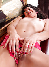 Latina Anilos Penelope plays with her hairy bush pussy