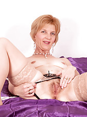 Playful cougar milf spreads her pink Anilos juice box before she masturbates in her bedroom