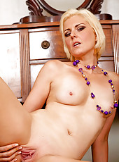 Sophisticated Anilos business woman strips and spreads her shaved pussy