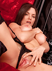 Horny milf Rebekah Dee fucks herself on the bed really hard and spreads her ass