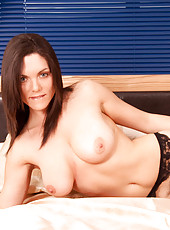 Hot Anilos babe spreads her pussy lips to display her pink clit on her bed