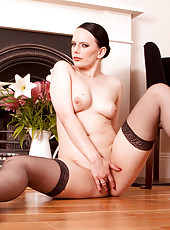 Fully nude cougar flaunts her flawless body as she fingers her pink Anilos pussy on the floor