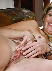 Enticing Anilos Rosetta wears business attire as she spreads her pussy wide open