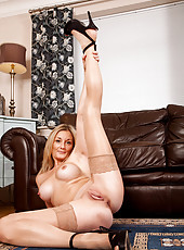 Nude milf Scarlet spreads her long legs for a clear view of her mature shaved pussy