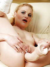 Cougar Scarlette Sax fucks her pussy with a giant dildo and licks her cum off afterwards