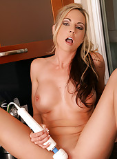 Horny Anilos Sindy Lange fucks her mature pussy in the kitchen