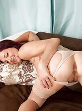 Horny redhead Sofia Matthews fucks her milf pussy with a silver vibe