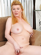 Anilos housewife Venice Knight plays with her shaved pussy while home alone
