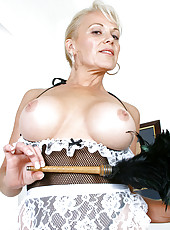 Horny housewife Veronica pops out her huge tits while spreading her mature pussy with the handle of a feather duster