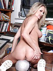 Hot Soccer Mom Bridgette Lee shows off her big tits and shaved milf pussy