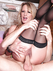 Experienced blonde Bridgette Lee sucks the hard stiff cock of a young stud before she gets fucked hard